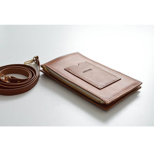 Angle view of XL Cognac Travel Purse (Cellphone Case) with card slot and strap