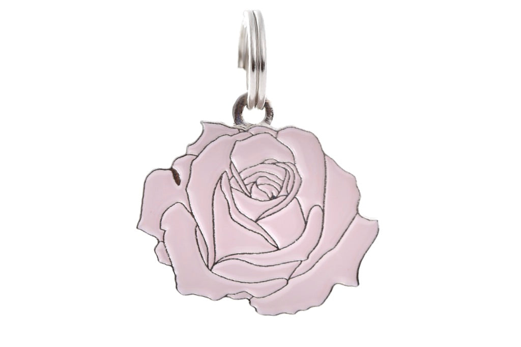Pet ID tag made of silver plated brass and pink enamel that is shaped like a rose.