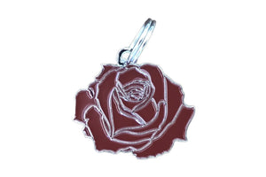 Pet ID tag made of silver plated brass and red enamel that is shaped like a rose.
