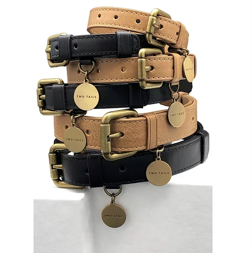 A pile of our brown and black leather pet collars in all three different sizes.