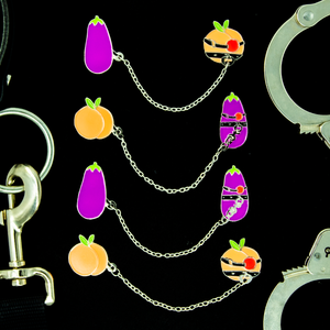 A display of all four variants of the kinky fruit pin sets.