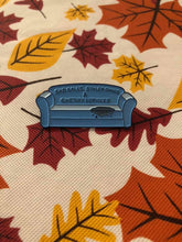 A customer's display of the couch pin with an autumn leaves linen backdrop.