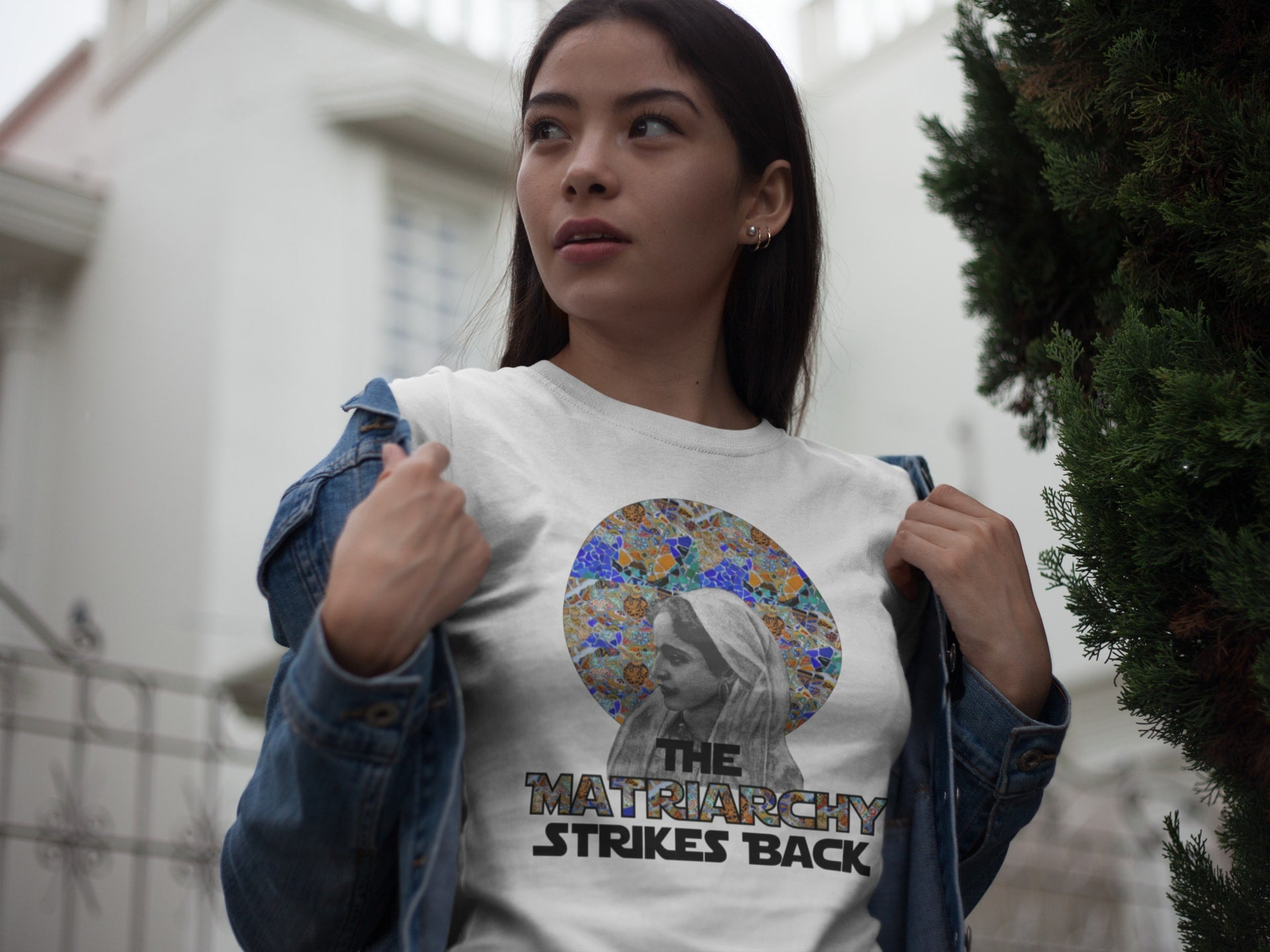 This is a photo of a model wearing Montevideo's The Matriarchy Strikes Back Feminist t shirt