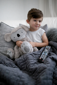 Here's How a Weighted Blanket Can Help Your Child Destress and Fall Asleep Easier
