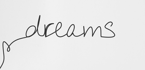 Connections between dreams and sleep quality - a pen with 'dreams' scribbled on a piece of paper.