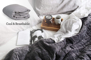 Are weighted blanket too hot? Not with our breathable cotton fabric! Image shows the Calming Blanket on a bed.