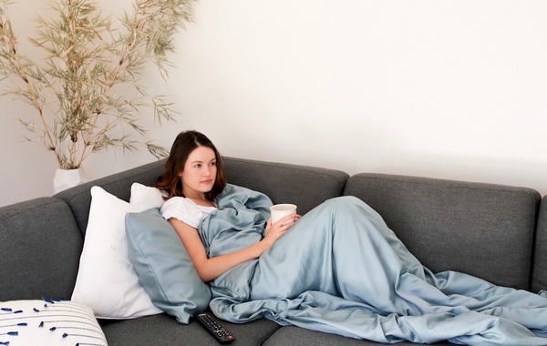 bamboo weighted blanket being used drinking tea