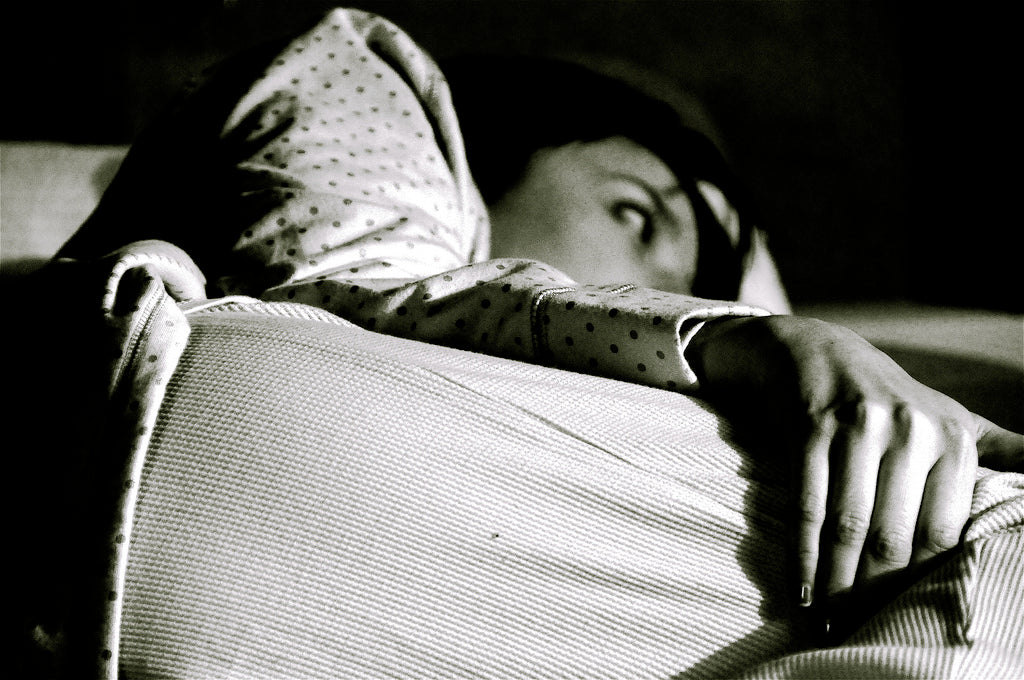 woman in bed not able to sleep