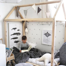 child using his grey blanket in stylish room