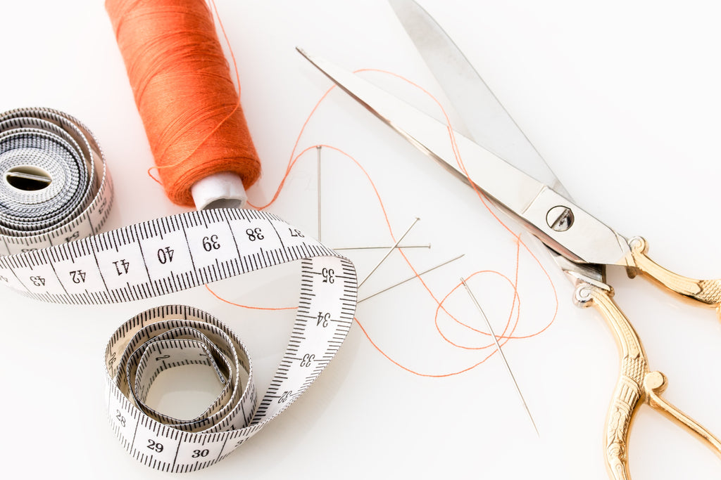 Sewing thread, measuring tape, and scissors for pattern making