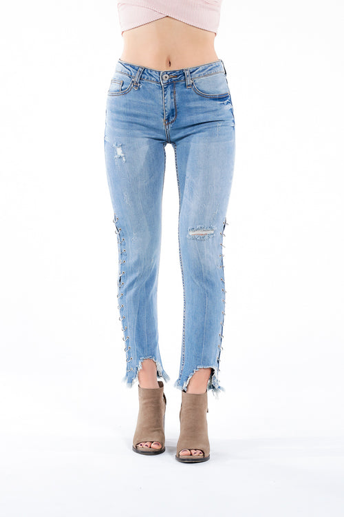Distressed high rise denim jeans with silver rings down the side of each leg