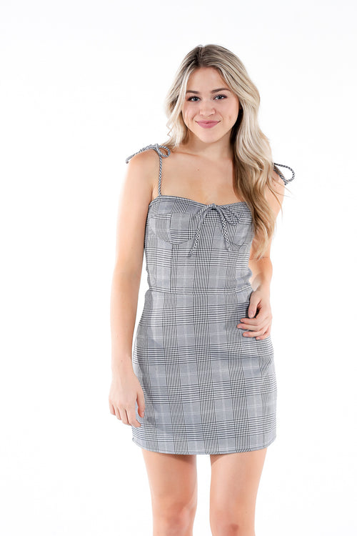Plaid form-fitting dress with spaghetti tie straps and front bowtie