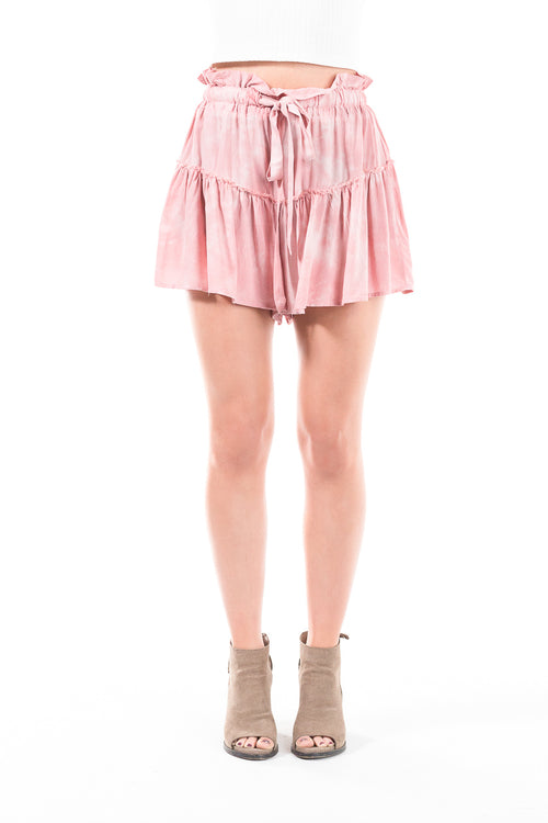Pink flowy shorts with drawstring and ruffled hems