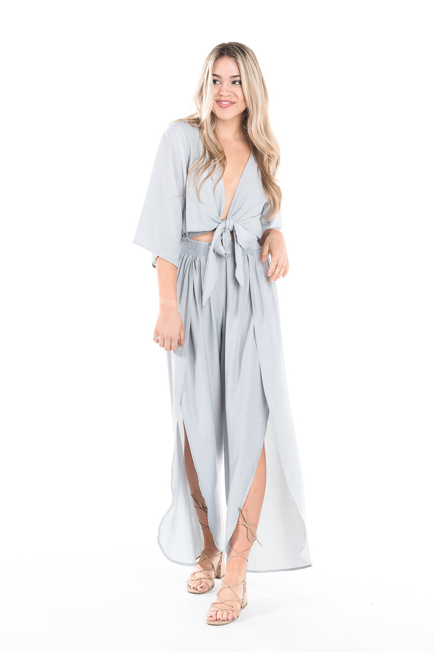 Silver flowy and airy jumpsuit with split leg openings and tie closure
