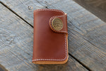 Blacksmith veg tan leather mid wallet in chestnut closed