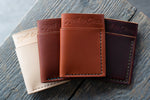 Flux veg tan leather wallets in natural, chestnut, tan and hickory