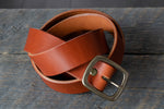 Garrison veg tan leather belt in tan coiled