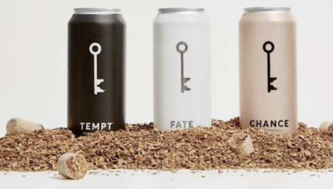 WineSociety flagship canned wines Tempt, Fate and Chance in a pile of corks