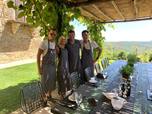 Angela and Austin spending time with friends at the Monteverdi Culinary Academy in Castiglioncello del Trinoro