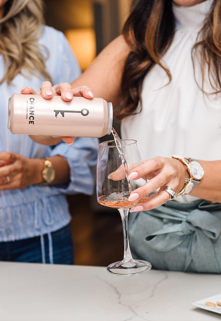 Woman in pouring CHANCE rosé wine /> </a>  <!-- <img alt=
