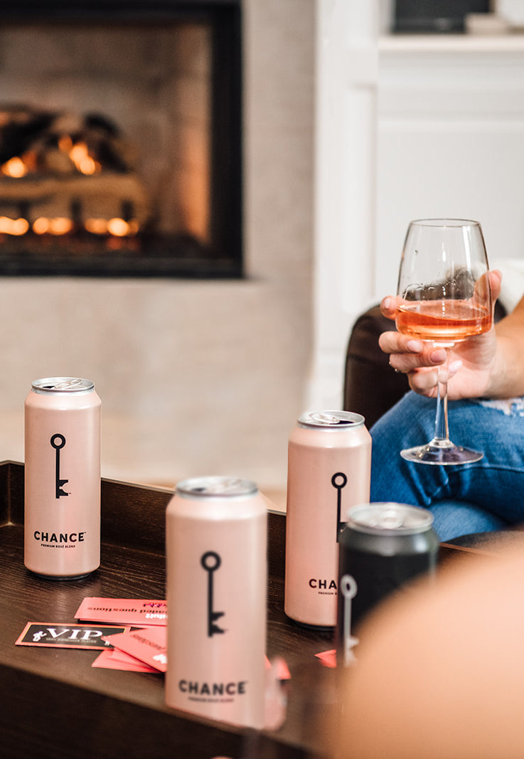 Cozy up by the fire with CHANCE rosé wine for the holidays