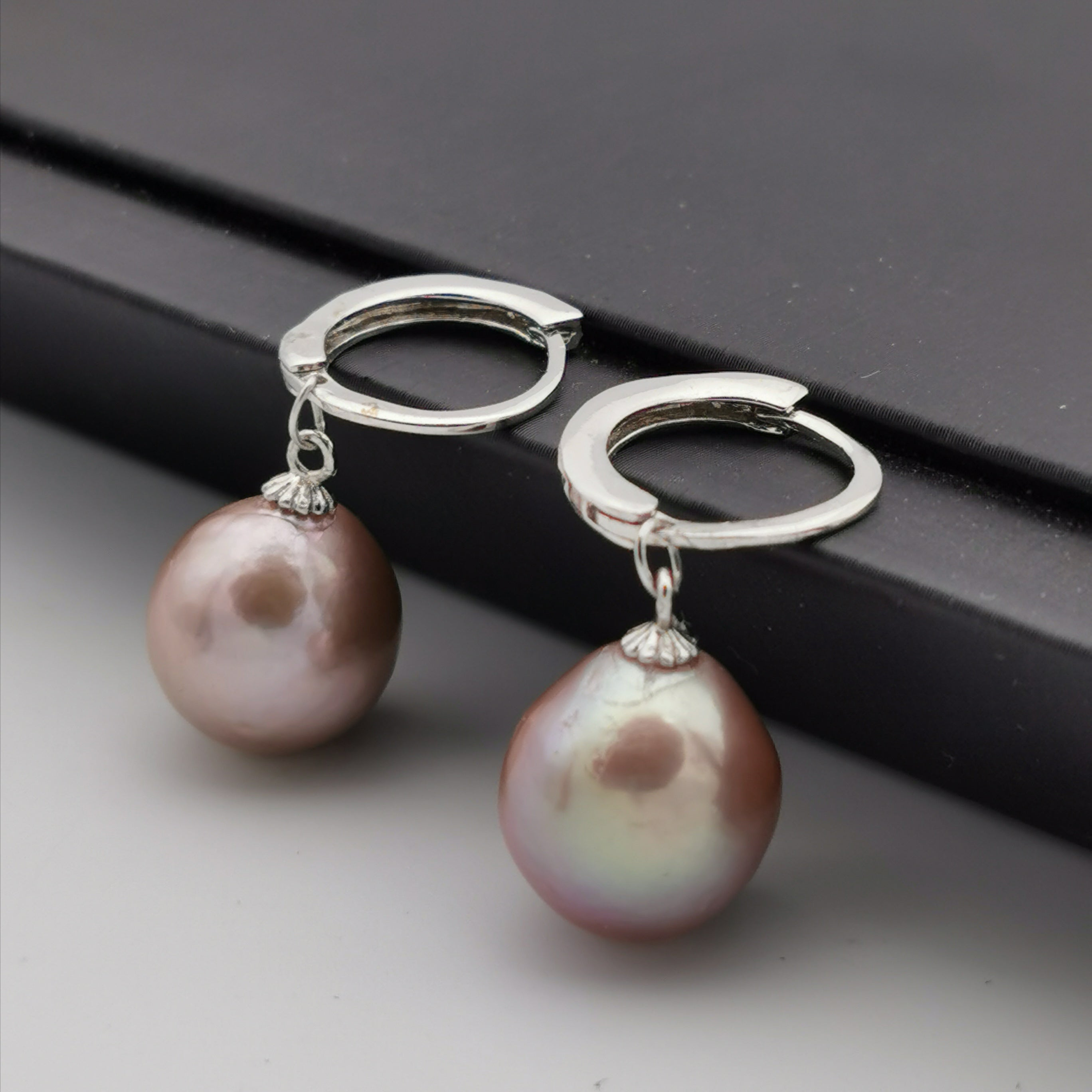 Sterling silver with purple freshwater baroque pearl dangling earring