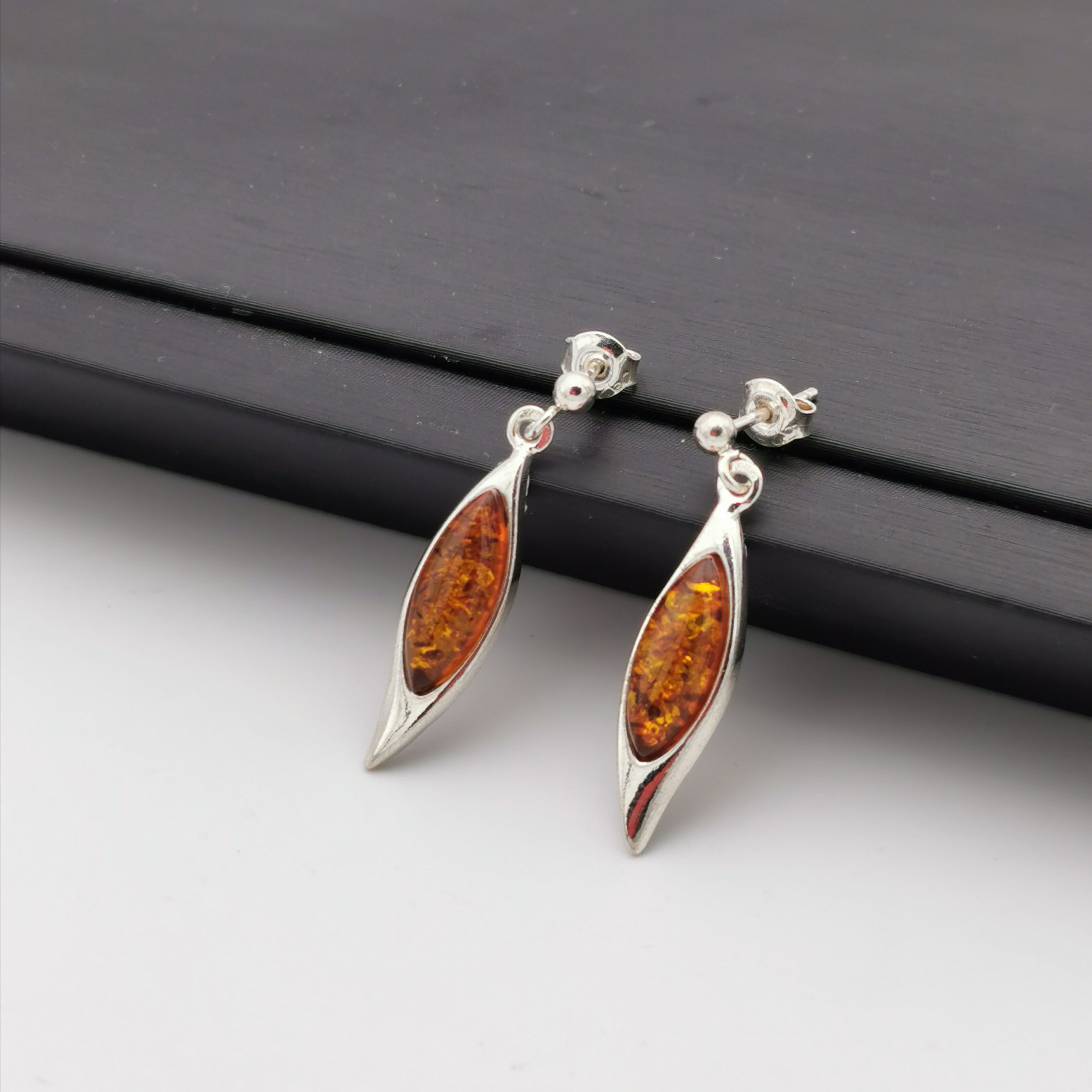 Dangling sterling silver with Baltic Amber earring