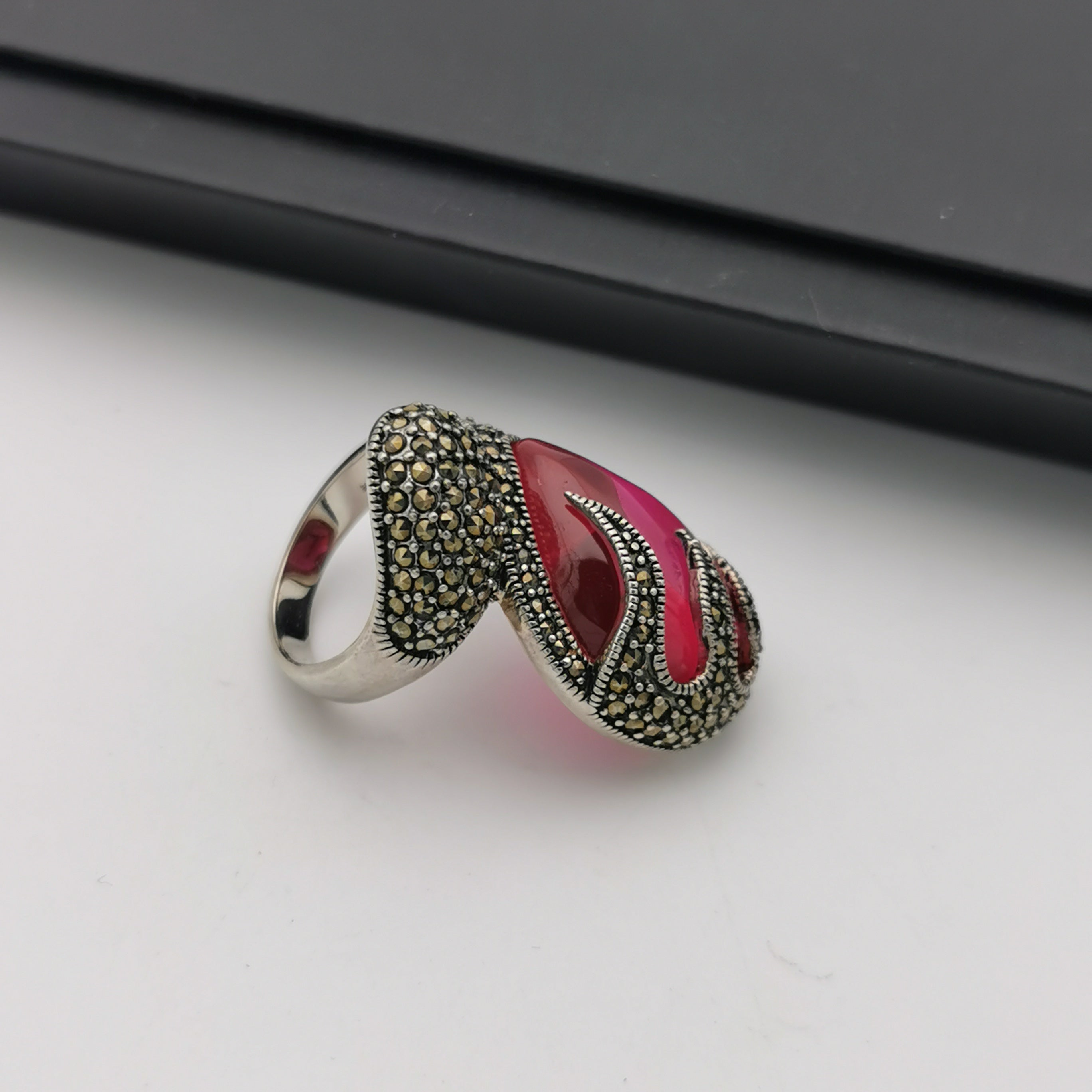 Exclusive sterling silver marcasite created ruby ring