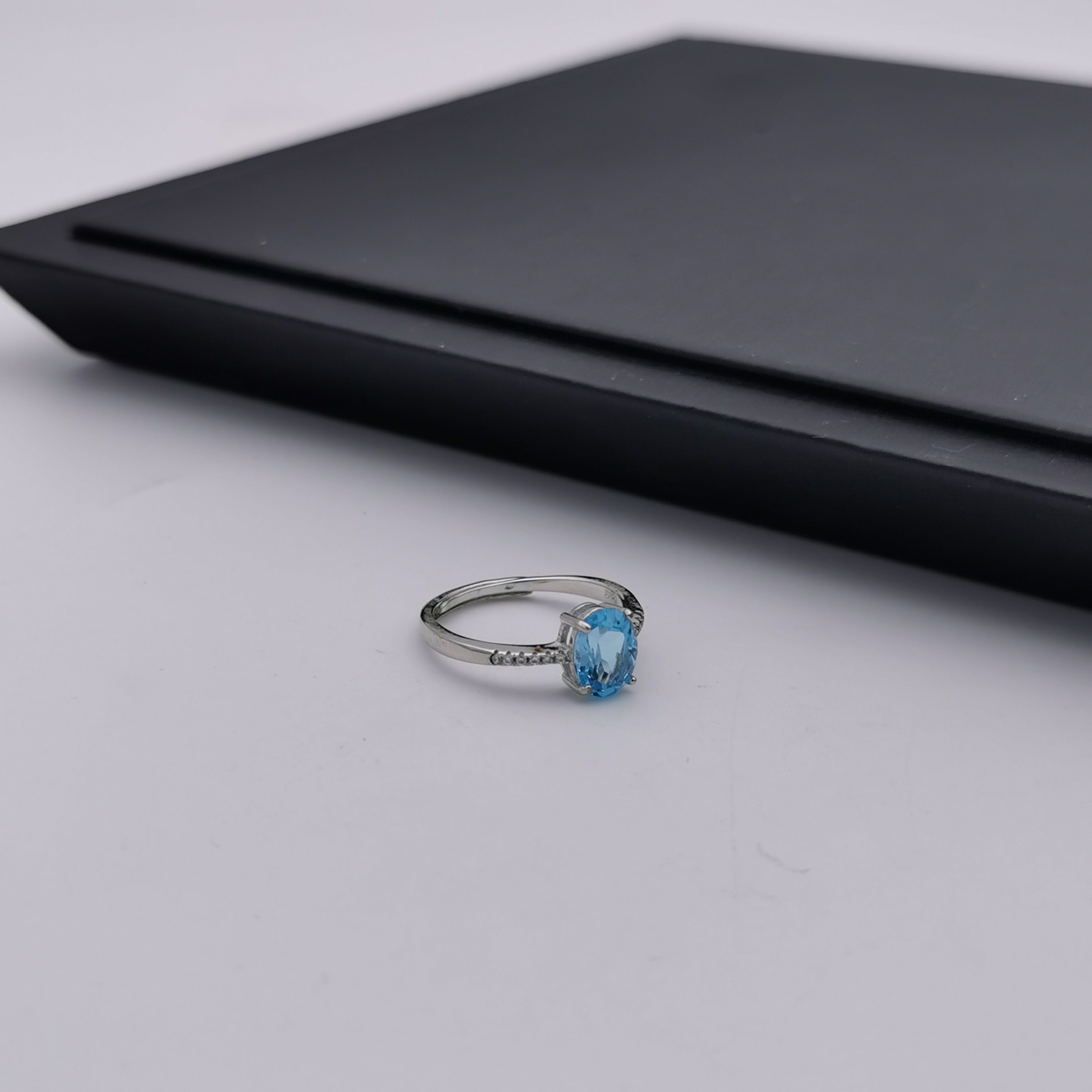 Sterling silver adjustable blue topaz ring