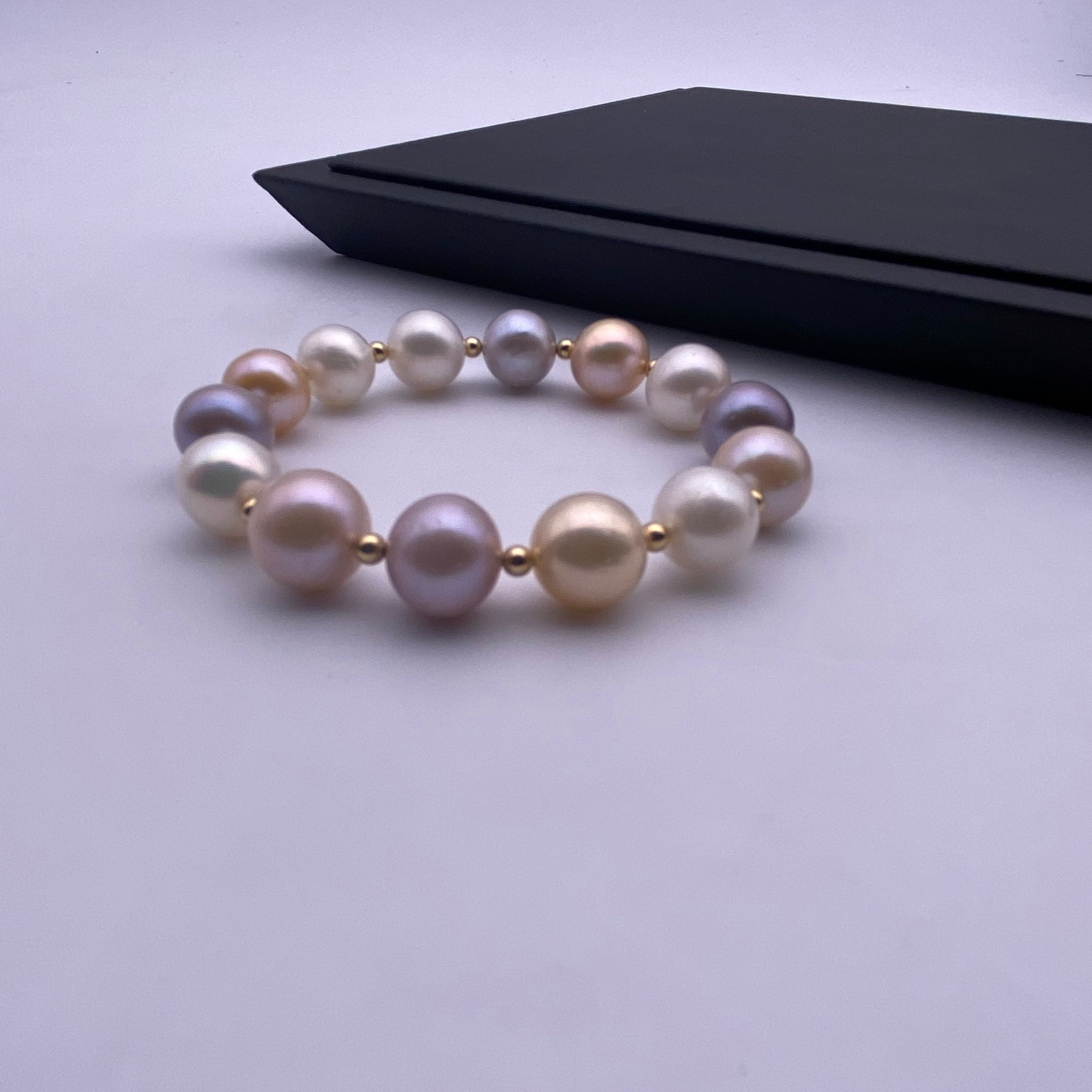 Multi colour freshwater pearl with rose gold alloy beads stretch bracelet