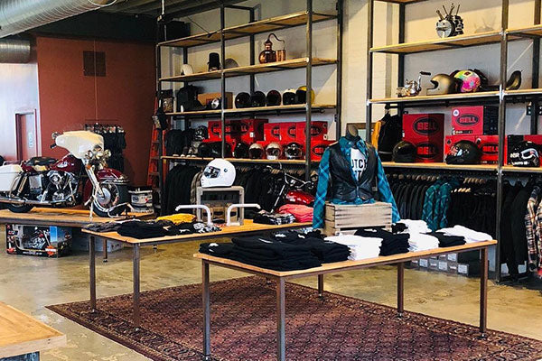 Inside photo of motorcycle shop with apparel and accessories.