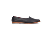 Side view of black flat leather shoes