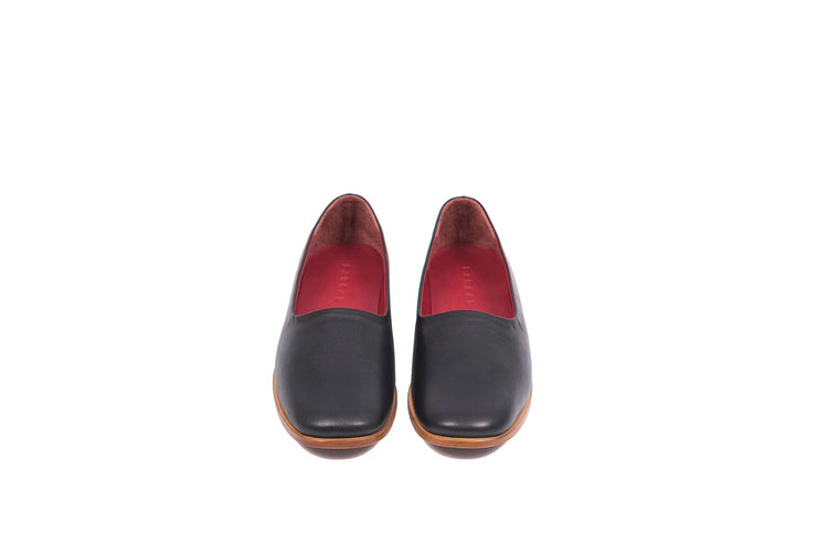 Front view of black flat leather shoes