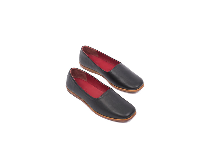 Top view of black flat leather shoes
