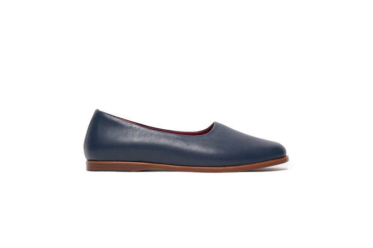 Side view of navy blue leather shoes