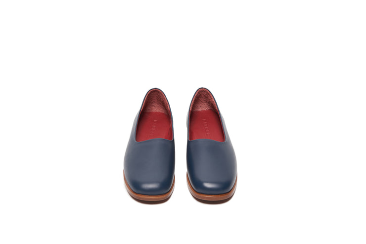 Front view of navy blue leather shoes
