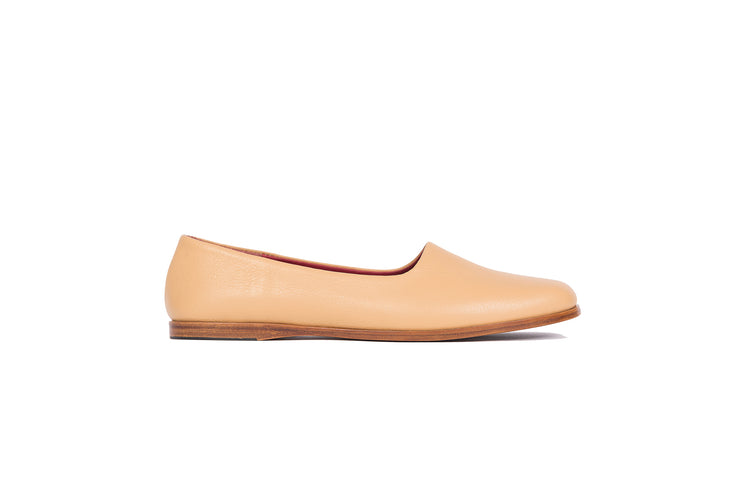 Side view of tan flat leather shoes