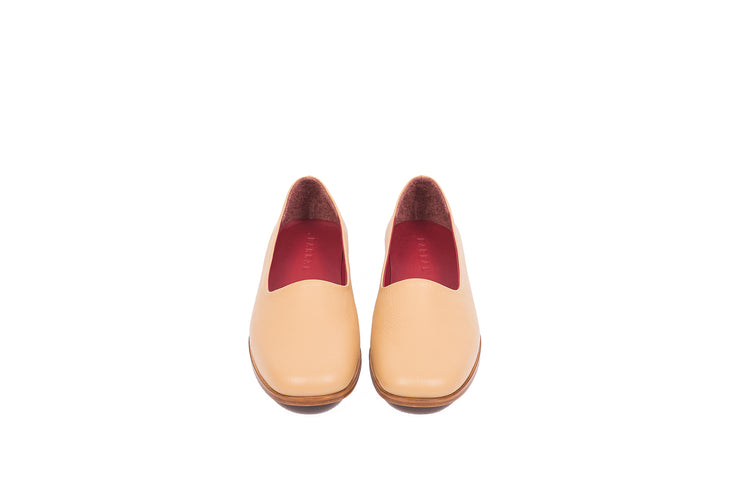 Front view of tan flat leather shoes