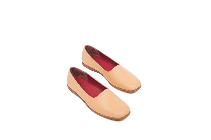 Top view of tan flat leather shoes