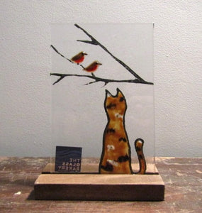 Fused Glass tile featuring the reverse of a ginger tortoiseshell cat watching a pair of robins