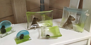 A collection of fused glass home decor featuring brown bears