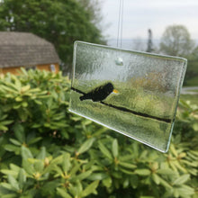 Load image into Gallery viewer, Glass suncatcher featuring blackbird on a wire