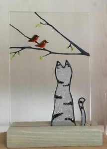 Grey Tabby Cat with a pair of Robins sitting on a branch: Glass Art Tile by The Glass Bakery
