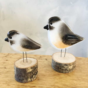 A large and small glass Black Capped Chickadee