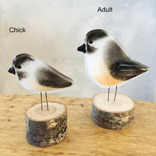 Load image into Gallery viewer, Two glass chickadee ornaments (black, white and buff coloured glass)