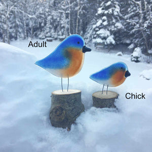 Two blue, tan and white glass bird ornaments modelled on the Eastern Bluebird