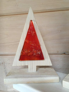 A red glass and white-washed wood Christmas Tree design table top decoration