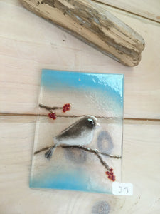 Glass tile featuring a Dark Eyed Junco sitting on a berry laden branch