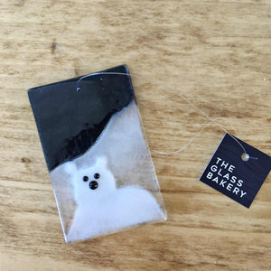 A  glass picture tile by The Glass Bakery featuring a Polar Bear nestled in front of what could be his Parent. Christmas Decoration.