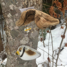 Load image into Gallery viewer, Glass Brown Bird with Yellow Beak hanging from a piece of driftwood.